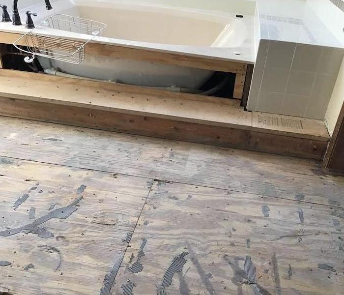 Bathtub with an exposed subfloor and tub sides