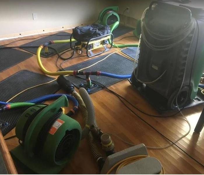 SERVPRO drying mats on hardwood floor