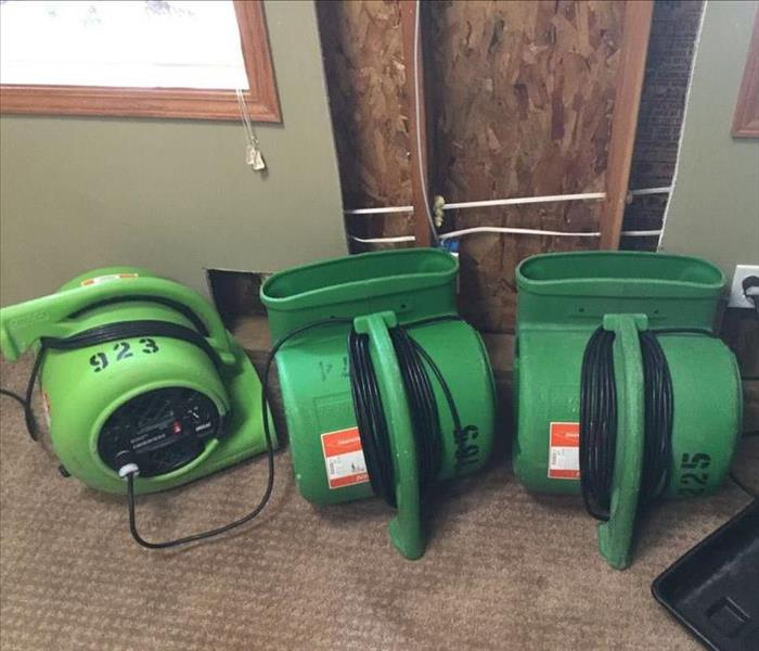 SERVPRO equipment sitting on the flooring in a home.