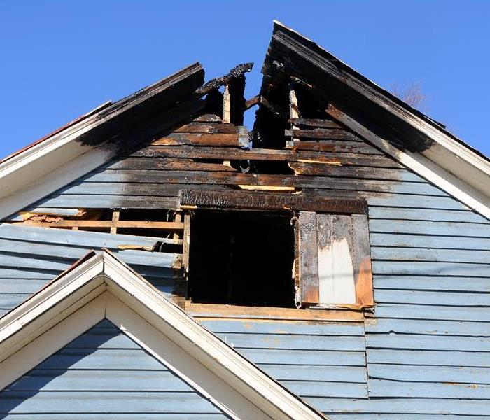 Fire damage to the roof of a home.